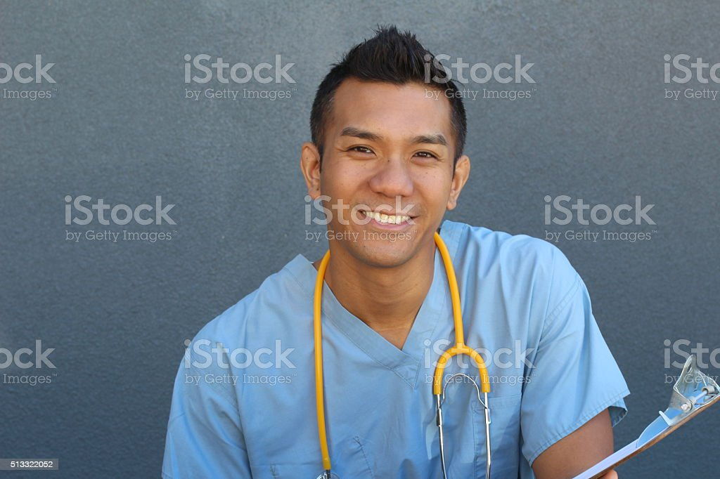 Smiling Asian male nurse with copy space on the left stock photo