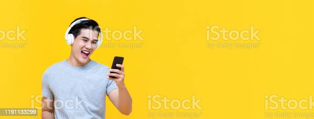 Smiling asian man wearing headphones listening to music from picture id1191133299?b=1&k=6&m=1191133299&s=612x612&h=q5 o hemxidev465j3pcnfythgc5as3vr7osap6sdpi=