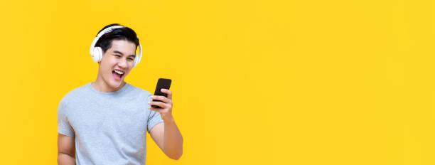 Smiling asian man wearing headphones listening to music from picture id1191133299?b=1&k=6&m=1191133299&s=612x612&w=0&h=ir1n mukhyuq6vkfkit3mh470m uqhyct6nib4 07sq=