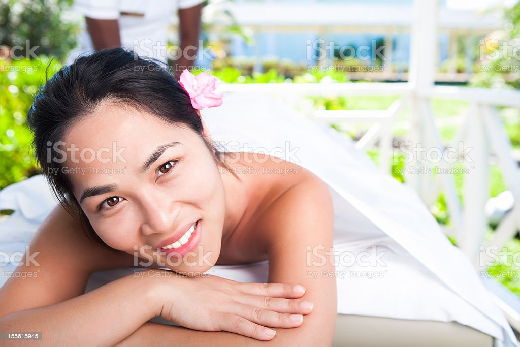 Smiling asian woman at the spa royalty-free stock photo