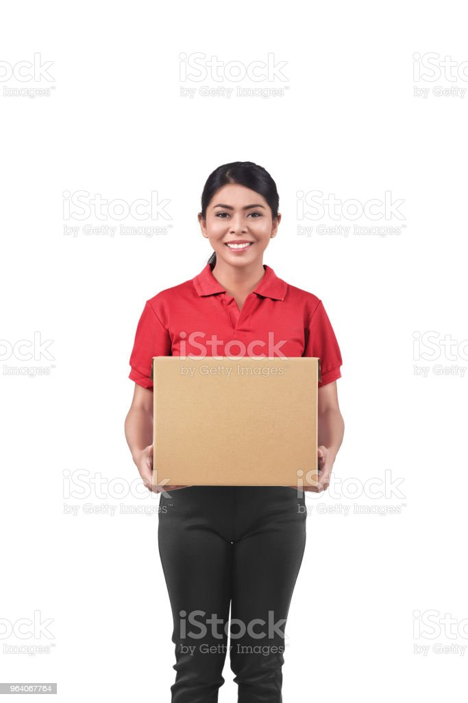 Smiling asian woman courier with cardboard box - Royalty-free Adult Stock Photo