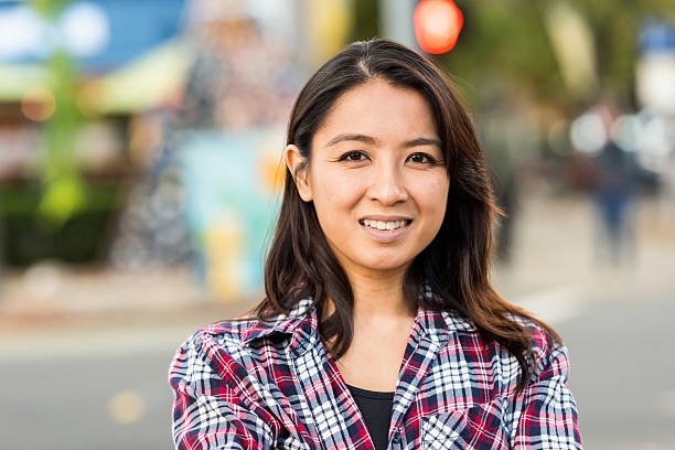 Smiling asian woman looking at the camera - Photo