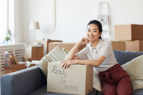 Smiling Asian Woman Ready to Move stock photo