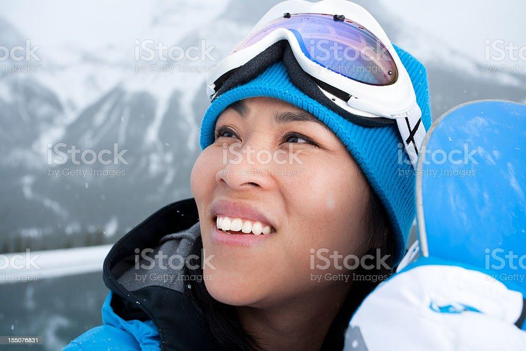 Smiling asian woman snowboard portrait royalty-free stock photo