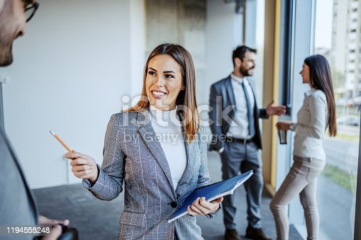 istock Smiling attractive female supervisor discussing with her employee about new ideas for building they renewing. Building in construction process interior. 1194555248