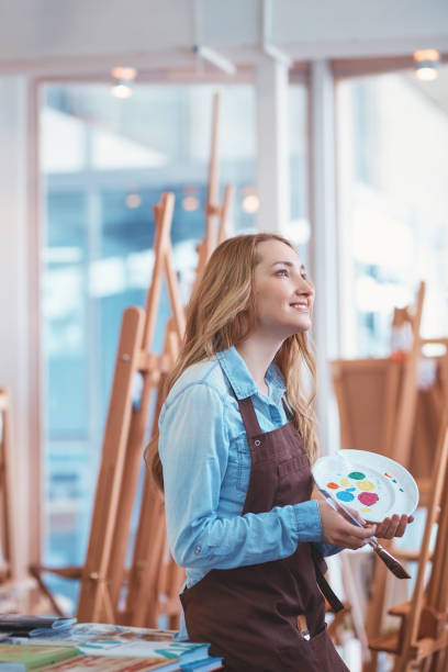 Smiling attractive girl at work in studio stock photo
