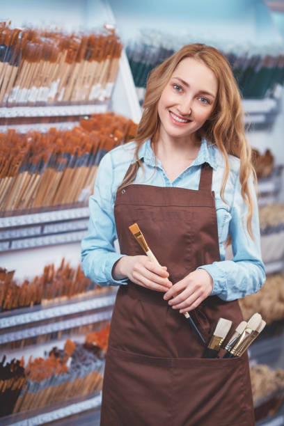 Smiling attractive girl with a brush stock photo