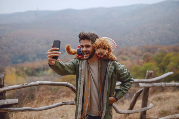 Smiling attractive mixed race man in raincoat taking selfie with his picture id1156414820?b=1&k=6&m=1156414820&s=612x612&w=0&h=ayrjdt gjd40 ii7okklmabkdb48g8upzvxkjimfj6y=