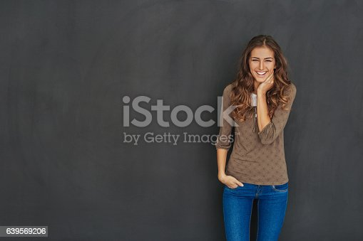 istock Smiling attractive woman at black background 639569206
