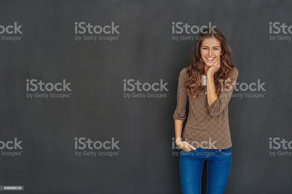 Smiling attractive woman at black background stock photo