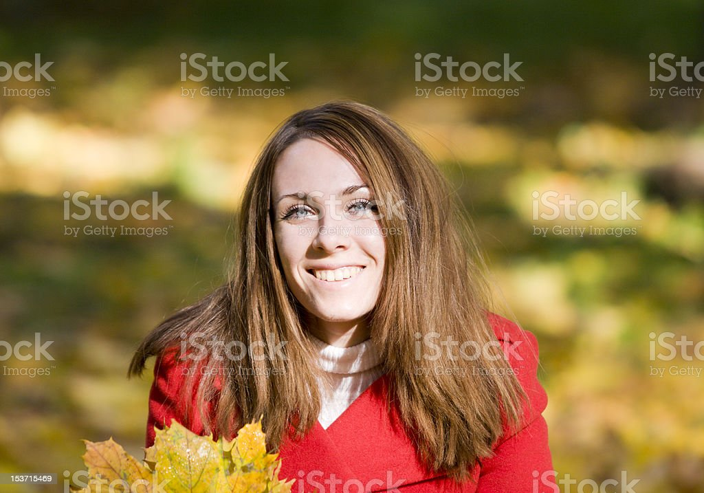 smiling attractive  woman with bouquet of autumn leaves stock photo