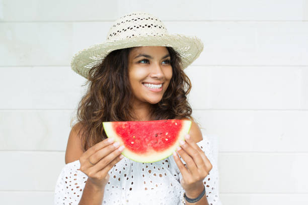 Smiling Attractive Woman With Slice of Watermelon stock photo