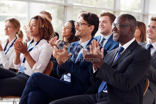 istock Smiling audience applauding at a business seminar 862718922