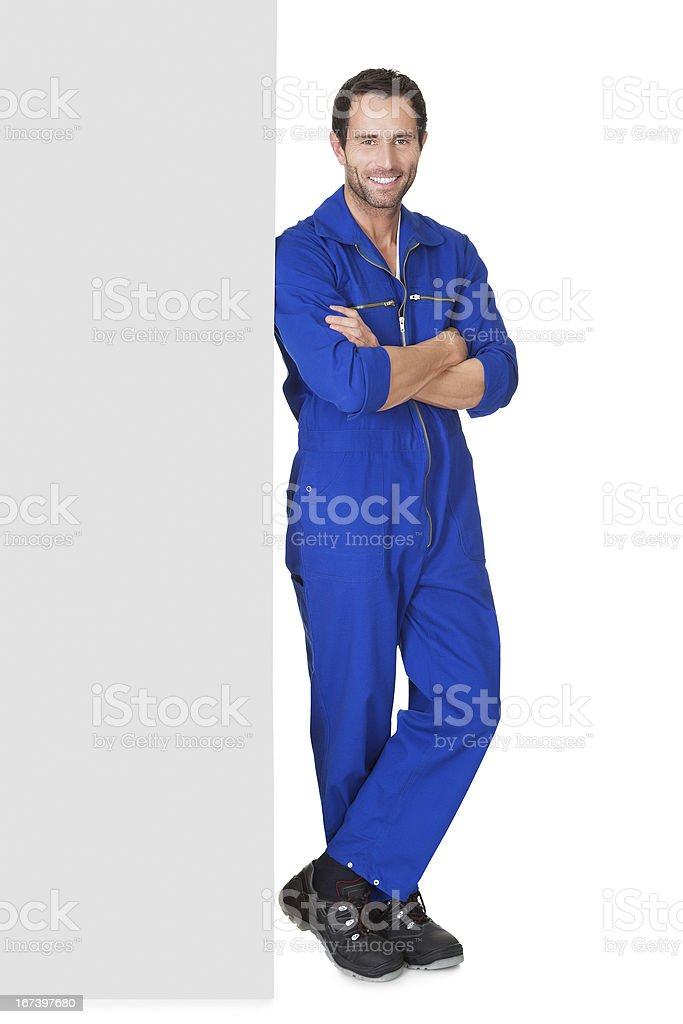 Smiling auto mechanic in coveralls royalty-free stock photo