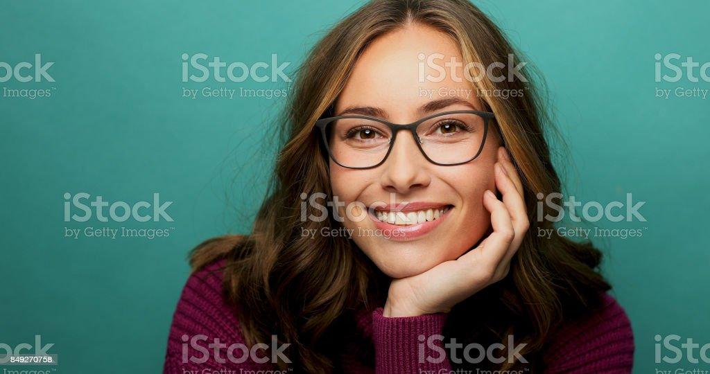 Smiling babe in glasses stock photo
