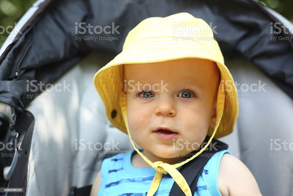 Smiling baby boy in a bucket hat stock photo