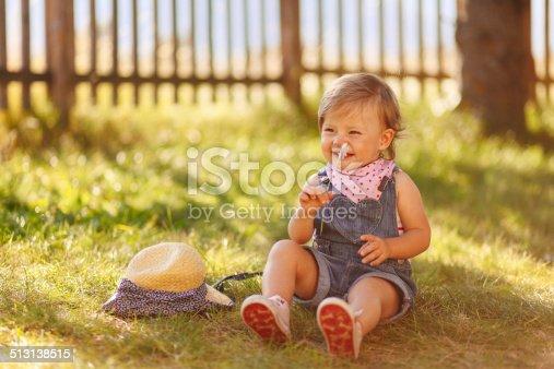 istock smiling baby girl 513138515