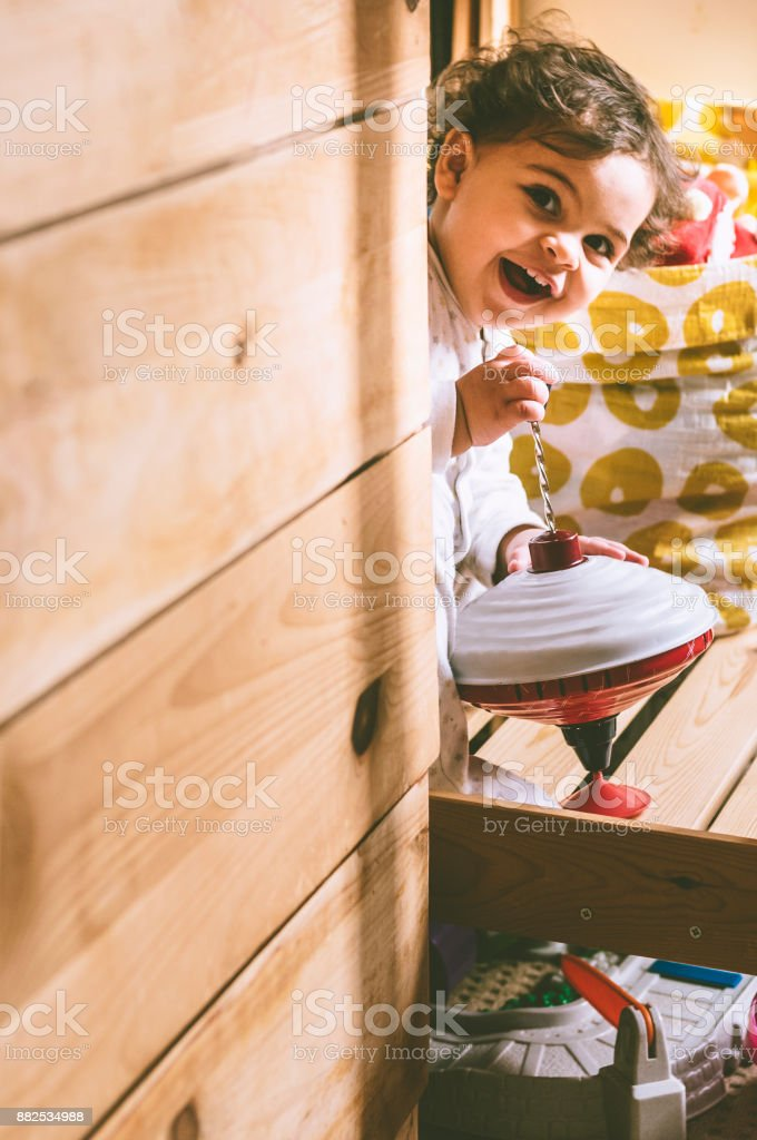 Smiling Baby Girl Playing stock photo
