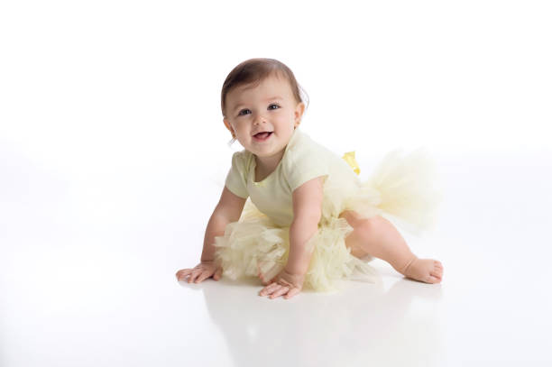 Smiling Baby Girl Wearing a Yellow Tutu stock photo