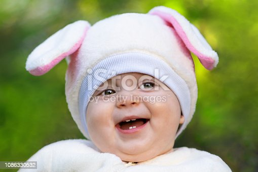 155096501 istock photo Smiling baby girl with fat cheeks. Close-up 1086330532