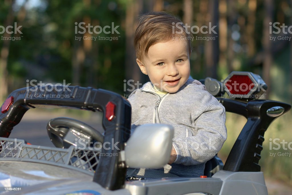 Smiling baby in a car royalty-free stock photo
