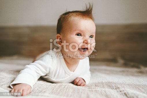 Smiling baby infant crawling at home adorable child portrait family lifestyle 3 month old kid