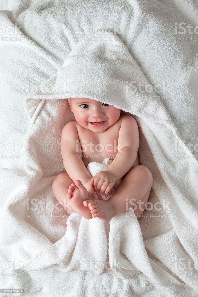 Smiling Baby Lying on Blanket stock photo