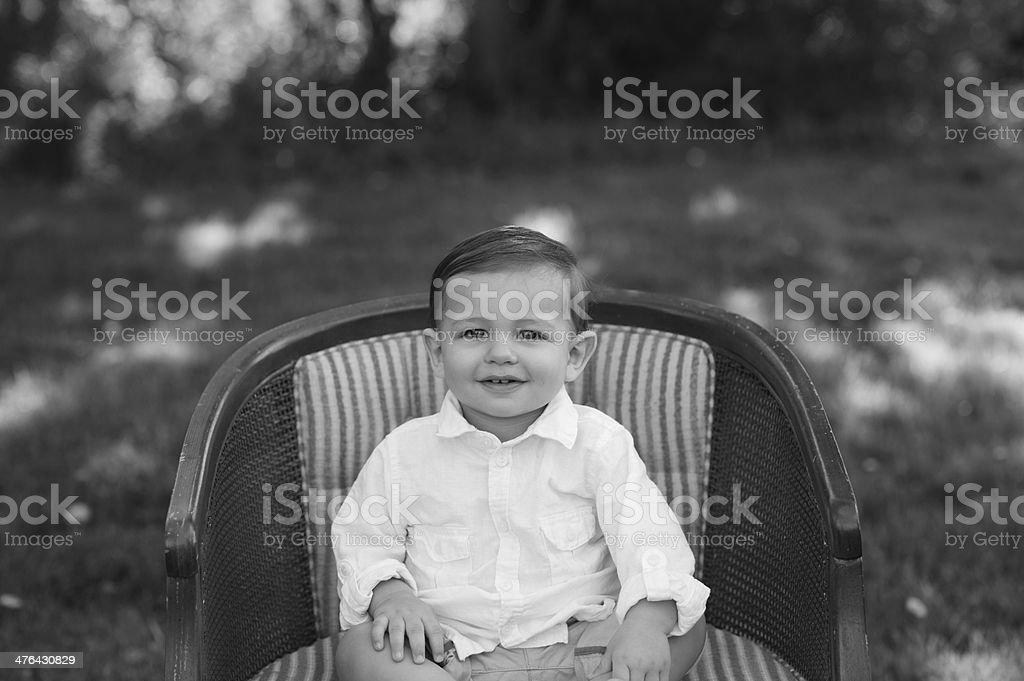 Smiling Baby Sitting on Chair royalty-free stock photo