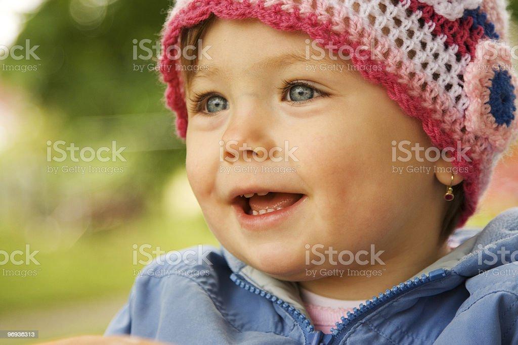 Smiling baby wearing hat royalty-free stock photo