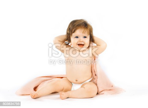 istock Smiling baby with a towel, health and hygiene - concept 503834755
