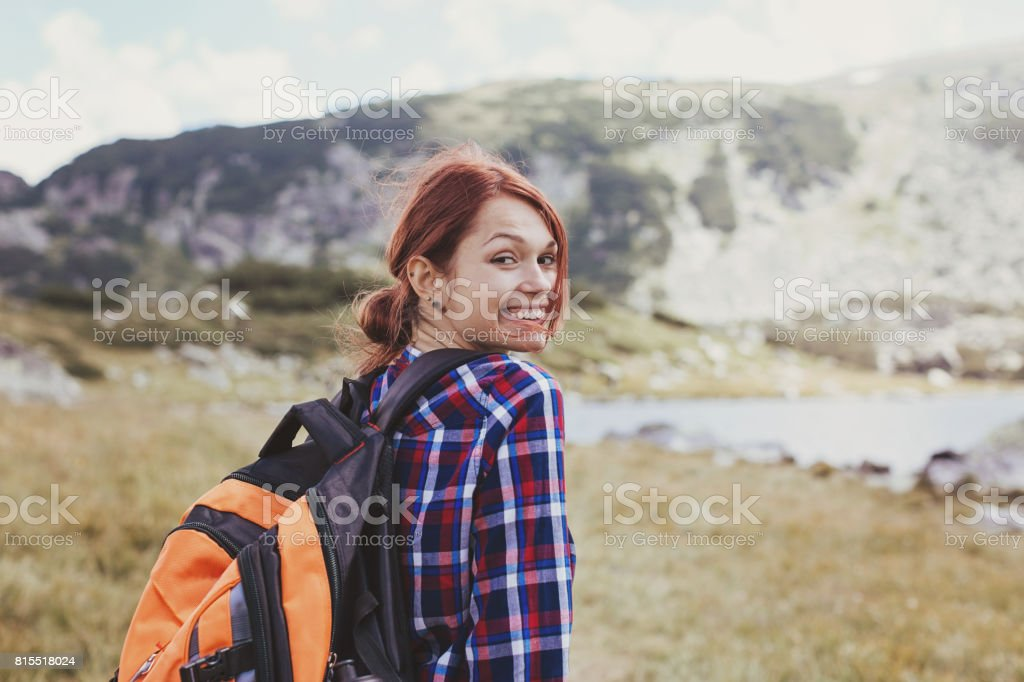 Smiling backpacker in the mountain stock photo