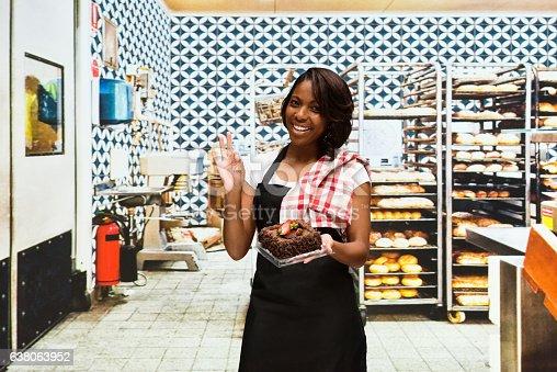545282128 istock photo Smiling baker giving ok sign in bakery 638063952