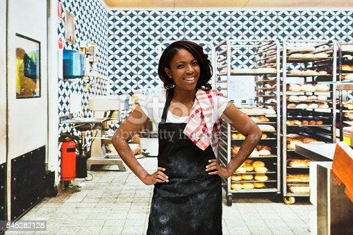 istock Smiling baker standing in bakery 545282128