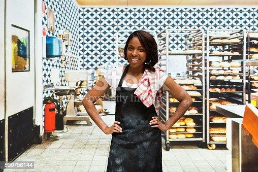 545282128 istock photo Smiling baker standing in bakery 599756144