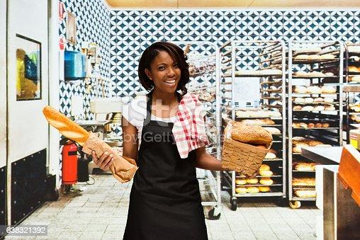 545282128 istock photo Smiling baker standing in bakery 638321392