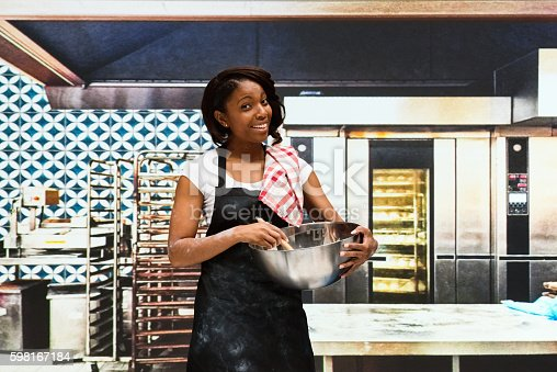 545282128 istock photo Smiling baker working in bakery 598167184