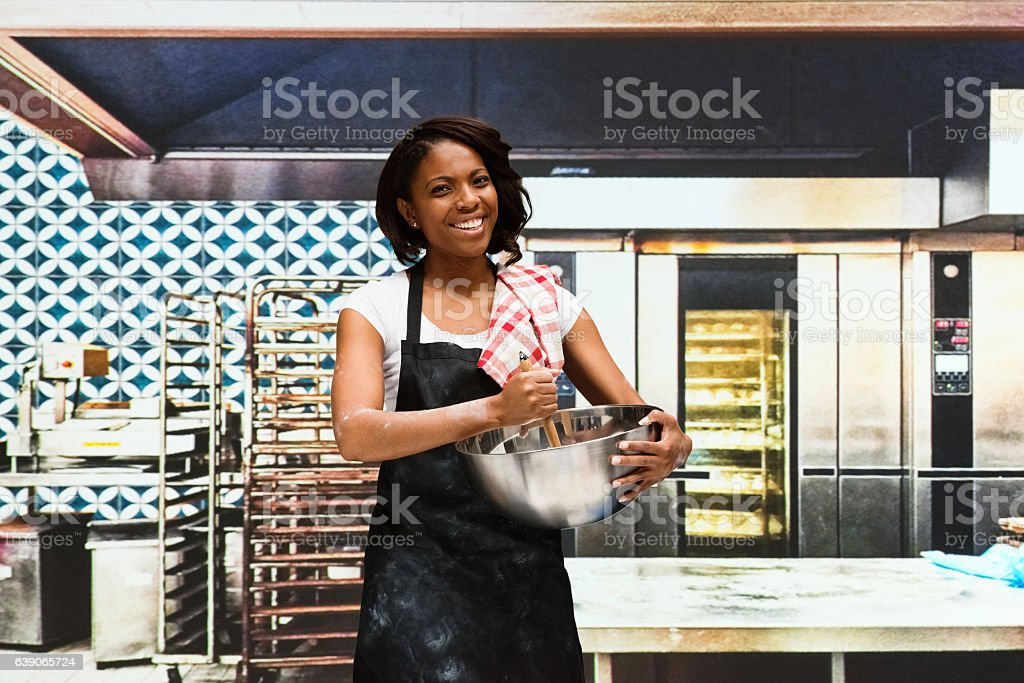 Smiling baker working in bakery stock photo