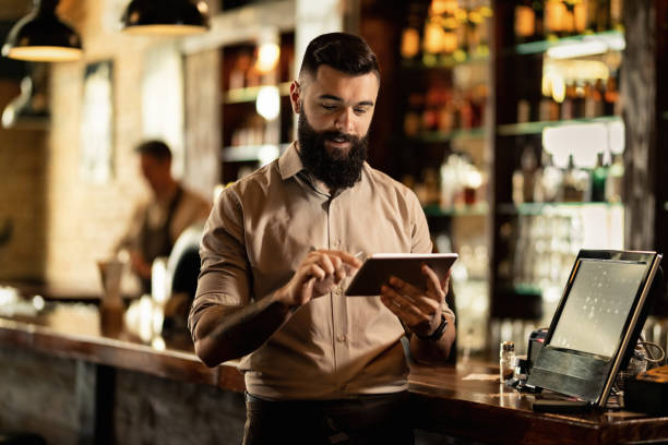 Smiling barista using digital tablet while working in a bar picture id1212064164?b=1&k=6&m=1212064164&s=612x612&w=0&h=ejaurv0jrqaz ygs2mzn4g7n9n7qasrsspgbc4rcu5u=