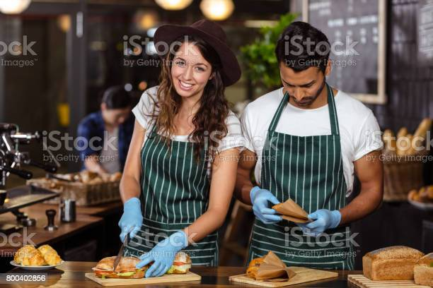 Smiling baristas preparing sandwiches picture id800402856?b=1&k=6&m=800402856&s=612x612&h=nmqvkmmvi hui6p8a277x06fquvyy3tlsaoaufj7m6m=