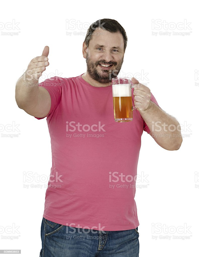 Smiling bartender inviting to taste a beer stock photo