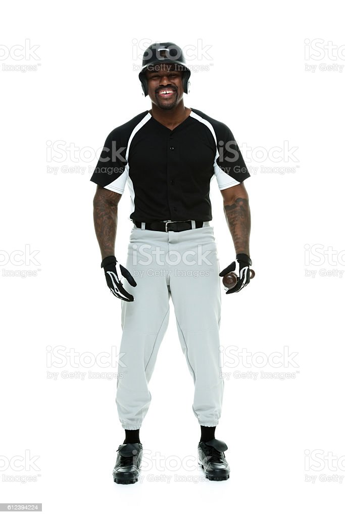 Smiling baseball player looking at camera stock photo