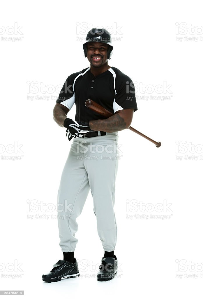 Smiling baseball player standing stock photo