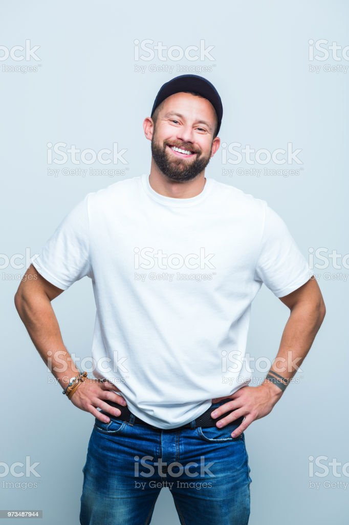 Smiling beard man standing confidently Portrait of smiling beard man with hands on hips on white background. Adult Stock Photo