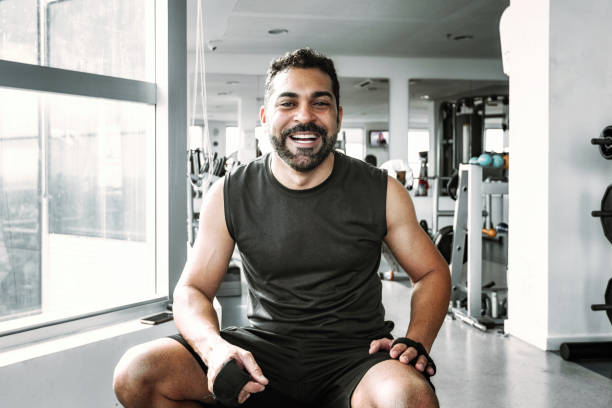 smiling bearded brazilian athlete in health club stock photo