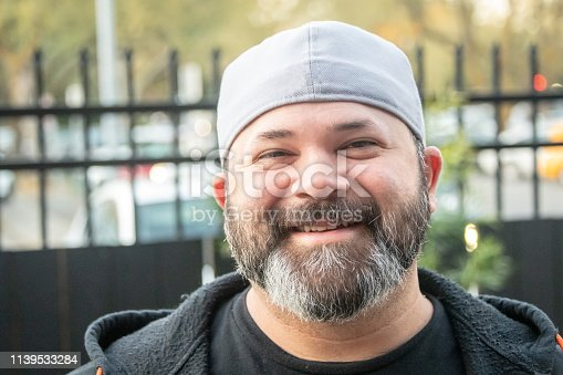 Smiling bearded man looking at the camera