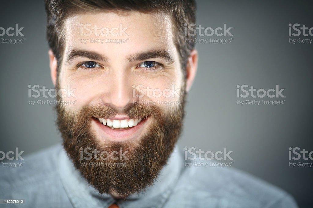Smiling bearded man. stock photo