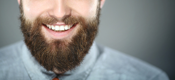 Smiling bearded man. stock photo