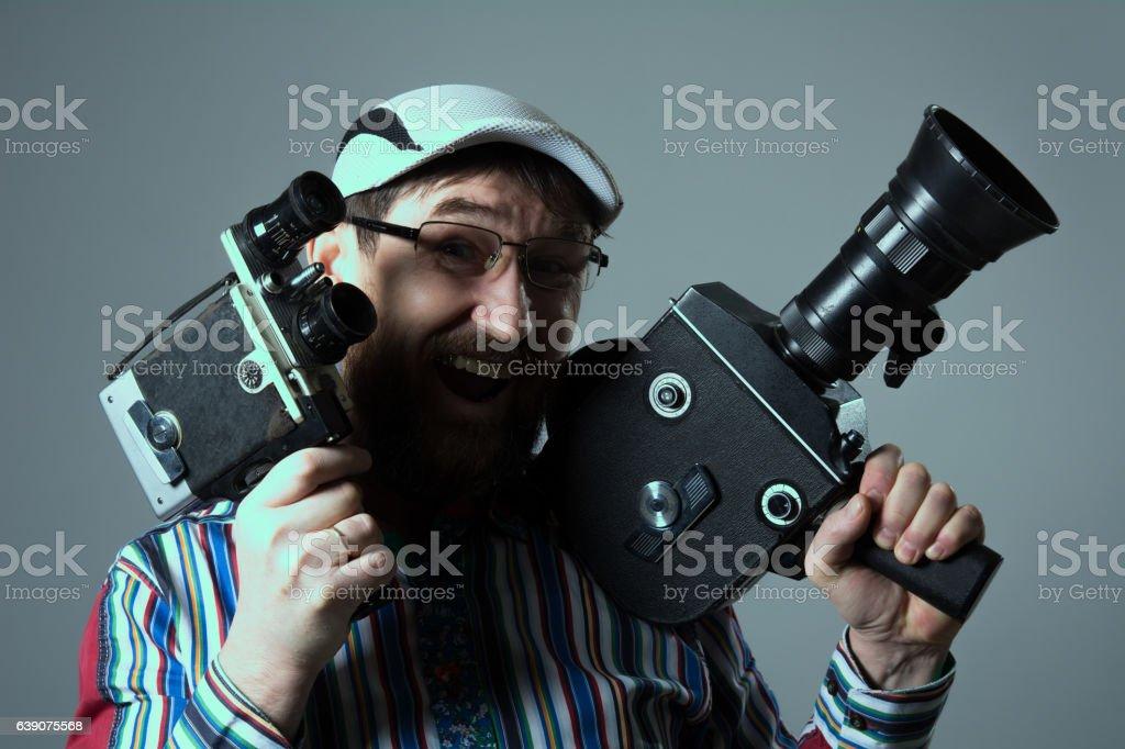 Smiling bearded man two old retro film camera stock photo