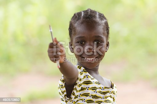 istock Smiling Beautiful African Child Holding Pen Up Education Symbol 492570852