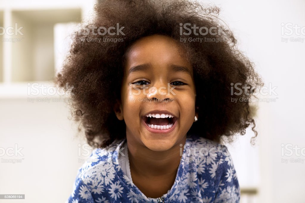 Smiling beautiful african girl with healthy teeth stock photo
